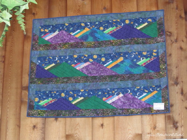 Beautiful handmade Quilt of Blues and Orchid colors