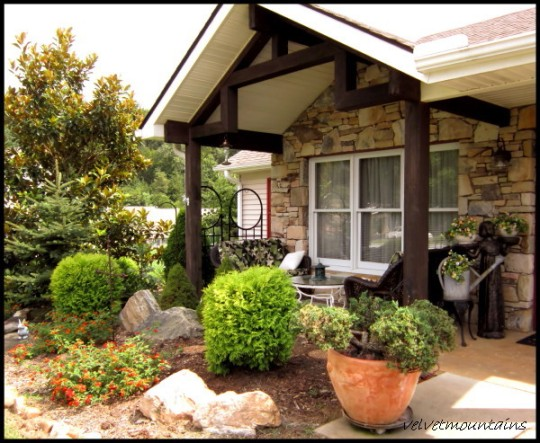 Pretty landscaping as you are entering the porch