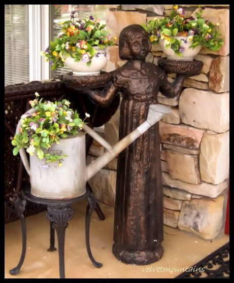 Beautiful little statue and flowers for an inviting entrance